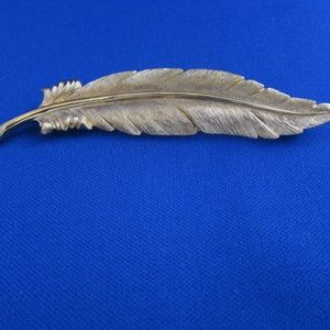 Vintage Monet goldtone feather pin